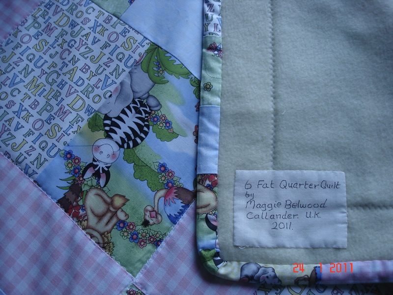 6 fat quarter cot quilt back 032.jpg